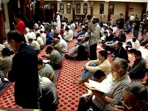 October 12 2001 MONTAGE worshipers praying in a mosque / Falls Church Virginia United States