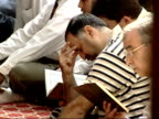 October 12 2001 MONTAGE Worshipers praying with beads and Korans in a mosque / Falls Church Virginia United States