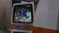 October 14 2009 ZO Patient on gurney being loaded into an ambulance outside hospital emergency entrance / Memphis Tennessee United States