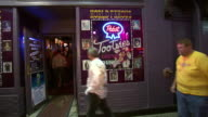 October 14 2009 SHAKY Patrons entering and exiting Tootsies Lounge / Memphis Tennessee United States