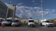 October 14 2010 PAN Various news media vehicles parked outside building / Nevada United States