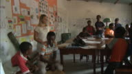 October 19 2010 PAN Students singing and dancing in a classroom in front of student audience / Mozambique