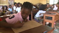 October 20 2010 MS Young students drawing at desks many chattering one absorbed / Mozambique