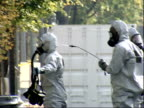 October 23 2001 ZI Hazmat workers spraying each other with decontaminating fluid at the Capitol Building / Washington DC United States