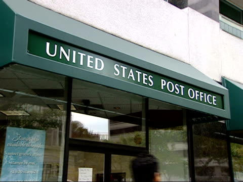 October 23 2001 ZI United States Post Office sign above strip center shop / United States