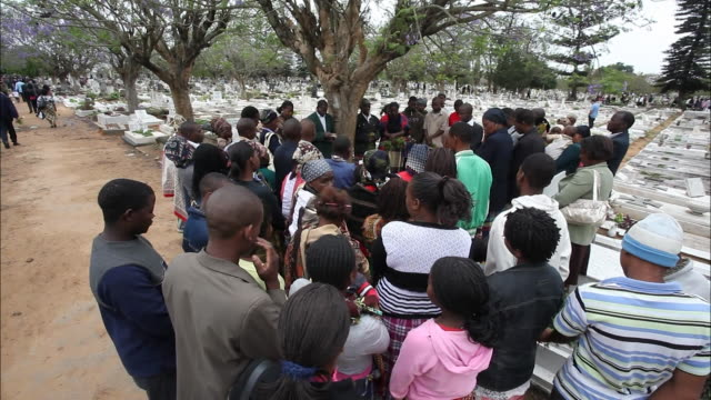 October 23 2010 HA Large group of Mozambicans gathered for a funeral in a cemetery / Mozambique