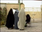 October 9 2004 Women lining up outside polls to vote in first national election / Kandahar Afghanistan / AUDIO