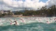 Oen water swimming race Waikiki Hawaii lead swimmers with Waikiki Beach in background