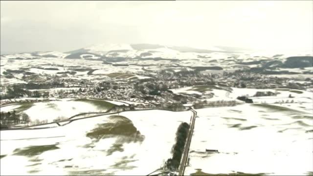 Kirkcudbrightshire VIEWS / AERIALS of snowy countryside / Castle Douglas farmers market empty / East Castle Douglas livestock in fields / Dumfries /...
