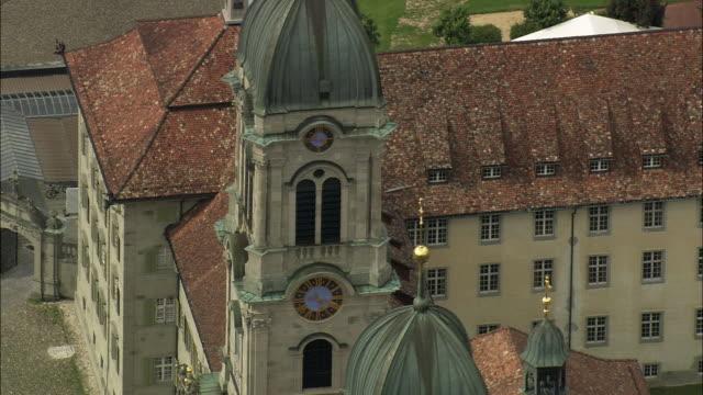 WS ZO AERIAL VIEW of Einsiedeln Abbey church with cityscape / Schwyz, Switzerland