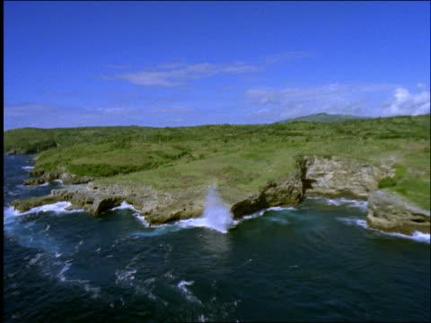 AERIAL of rocky cliffs + ocean / Nusa Pineda / Bali / Indonesia