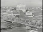 COMMONWEALTH of the PHILIPPINES HA WS Bridge w/ traffic people General Electric building w/ 'GE' sign BG WS 'Tokyo Bazar' on building w/ horse drawn...
