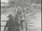 COMMONWEALTH of the PHILIPPINES DEFENSE Filipino soldiers training trotting across bamboo handmade pontoon bridge