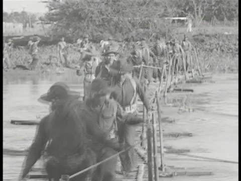 COMMONWEALTH of the PHILIPPINES DEFENSE Filipino soldiers training trotting across bamboo handmade pontoon bridge