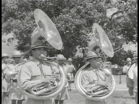 COMMONWEALTH of the PHILIPPINES DEFENSE First Infantry Division Philippines Army Band w/ Filipino men in uniforms playing tubas CU drum WS Color...