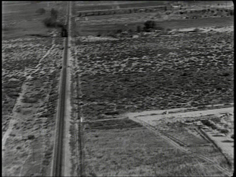 B/W AERIAL of train in countryside