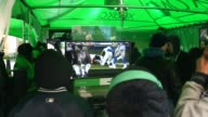 BROLL of various activities games and exhibitions set up for NFL fans in Time Square for Super Bowl XLVIII at MetLife Stadium Fans wearing winter...