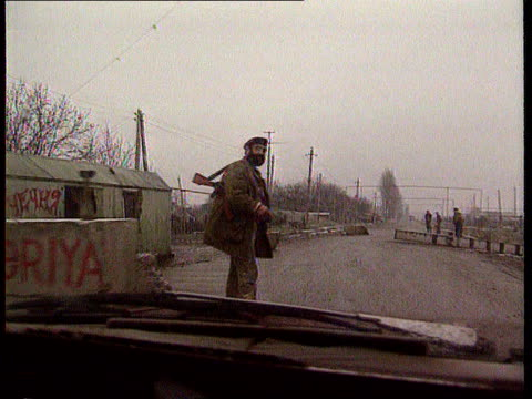 Ferry hijacking Offensive on Chechen rebels Ferry hijacking ITN LIB TX Grozny LMS TRACK FORWARD as up to road block TCMS SIDE Two Russian soldiers on...