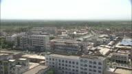 Office buildings tower over surrounding buildings in Turpan Silk Road China