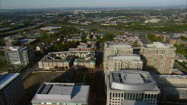 AERIAL Office buildings with Dulles Airport in distance, Reston, Virginia, USA