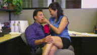MS Office romance, man and woman sitting in office and eating takeout food, Austin, Texas, USA