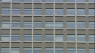 Office windows cover a facade of the Ibaraki Prefectural Government Office building.