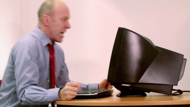 Office worker stressed with computer