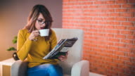 Office worker with coffee and magazine