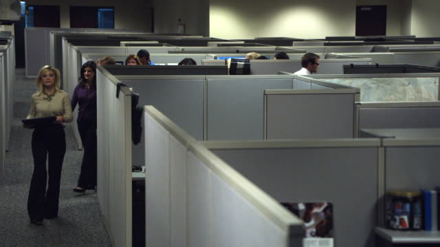 WS HA Office workers leaving cubicle, Dallas, Texas, USA