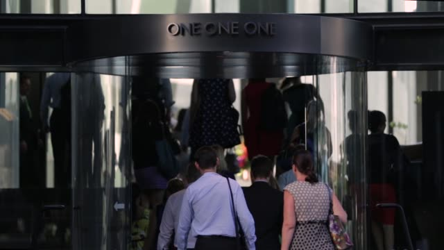Office workers walk through a building in Brisbane Australia on Tuesday Jan 12 Office workers enter a building in Brisbane Office workers enter a...
