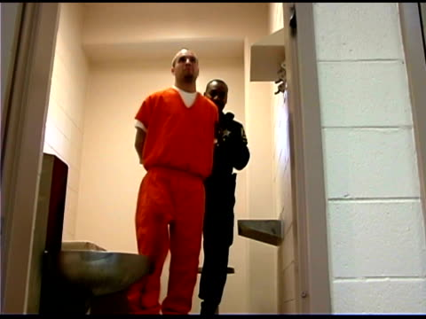Officer and prisoner walking