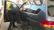 officer dismantles vehicle used to smuggle drugs / drugs hidden inside dashboard of vehicle / San Ysidro Port of Entry