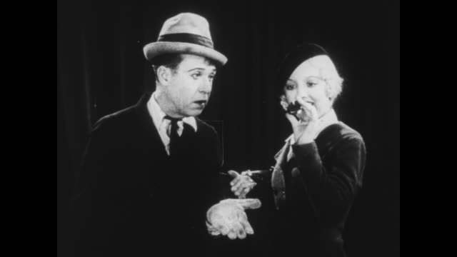 Officer Vernon Dent sticks pin in Harry Langdon to check if he is real or made of wax / pin prick makes him fall