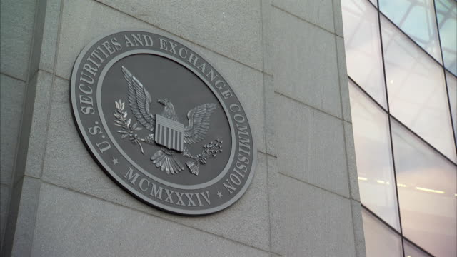 MS ZI Official seal and bank of windows on United States Securities and Exchange Commission building / Washington, Washington DC, USA