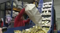 Officials in Bucharest oversee the destruction of hundreds of thousands of smuggled cigarette packages as part of a vast operation combating a...