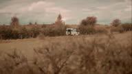 Off-road car driving through fields