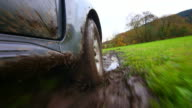 HD Off-road vehicle driving through mud POV