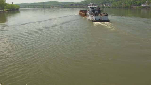 MS AERIAL TU Ohio River with moving tug boat and land / Maysville, Kentucky, United States