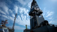 oil drill platform sailing under sky