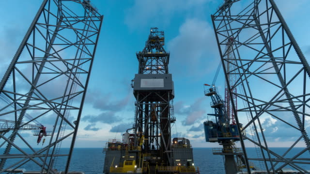 oil drilling rig with clouds time lapse morning time