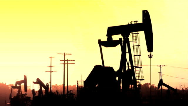 Ölfeld Sonnenuntergang Silhouette