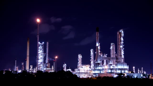 oil refinery at night, time lapse