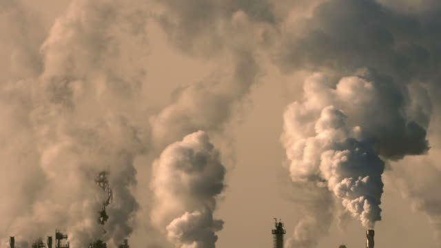 Oil refinery emitting green house gases