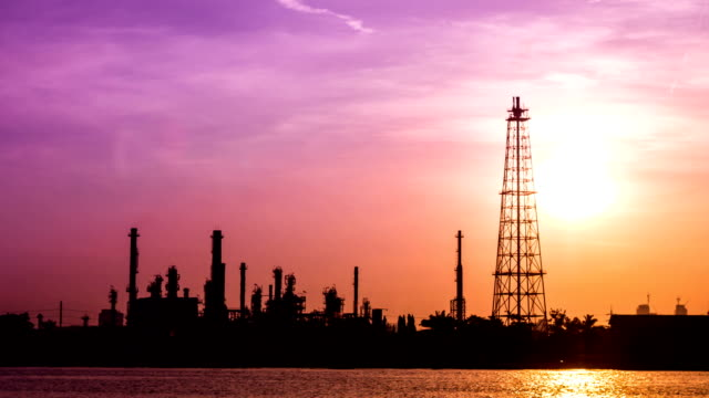 oil refinery plant with sunset
