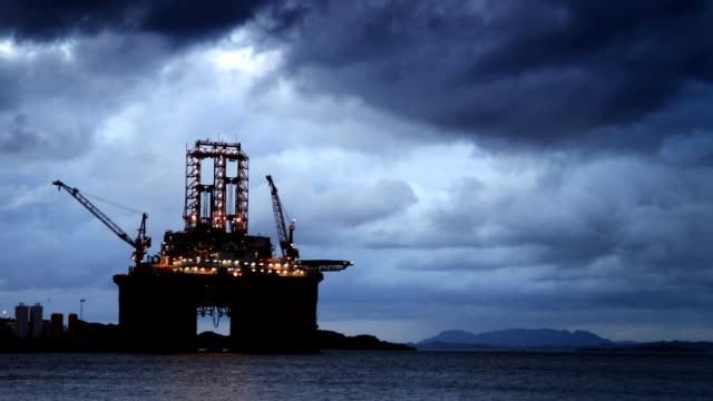 Oil rig under a stormy sky