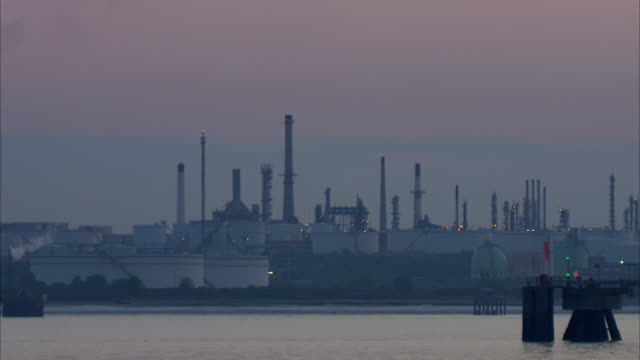 MS PAN Oil storage tanks and chimney stacks  flares at Fawley oil refinery / Southampton, Hampshire, United Kingdom
