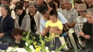 Okinawa marked the 70th anniversary Tuesday of the end of a World War II ground battle that claimed over 200000 lives with the local government...