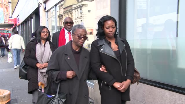Disciplinary hearing for six Metropolitan police officers T06031736 Croydon Various of family of Olaseni Lewis along towards coroner's court