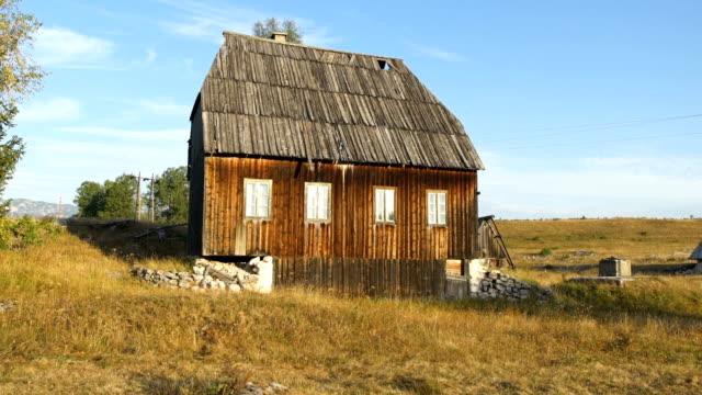 Old abandoned cabin. Autumnal landscape