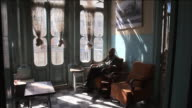 MS Old arab man drinking tea and near beautiful sun lit window. / Amman, Jordan